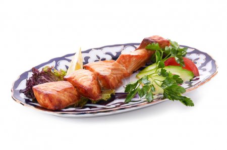 Photo for Meat on a grill with vegetables - Royalty Free Image