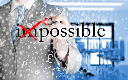 Photo for Businessman Hand turning the word Impossible into Possible with red marker - Royalty Free Image