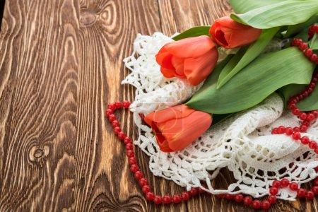 Tulip flowers on wood