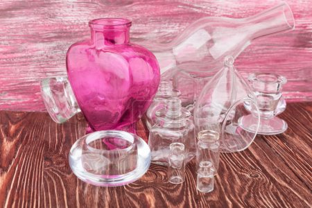 Glass vases on wood