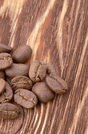 Photo for Aromatic coffee beans on wooden background - Royalty Free Image
