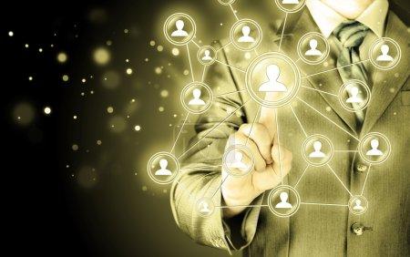Businessman pressing social icon