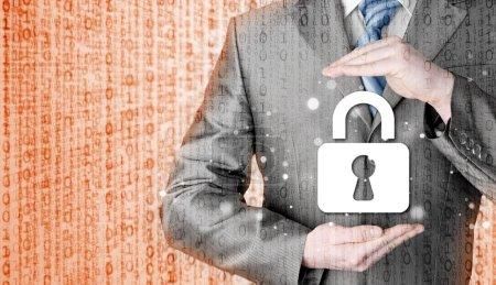 Businessman protecting lock