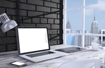 laptop and work stuff near window