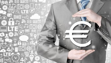 Businessman protecting euro