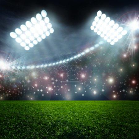 Arena in night illuminated by  spotlights