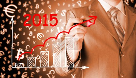 Photo for Businessman drawing growth graph for year 2015 - Royalty Free Image