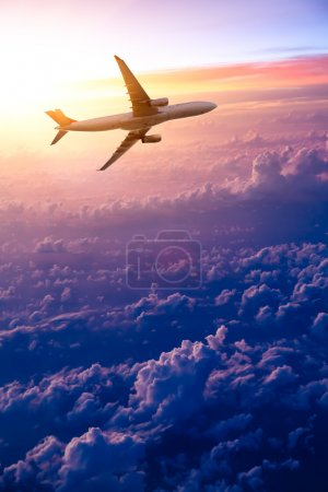 Photo for Airplane in the sky at sunrise - Royalty Free Image