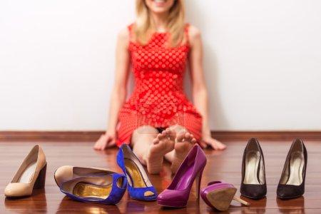 Girl choosing shoes