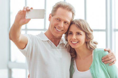 Beautiful couple with gadget