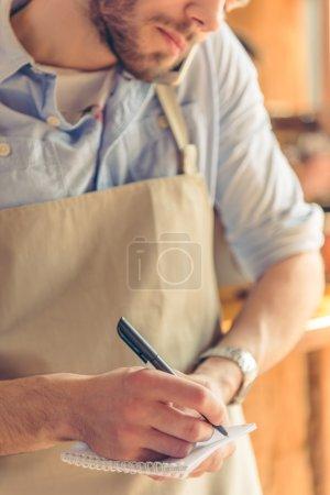 Handsome waiter at cafe