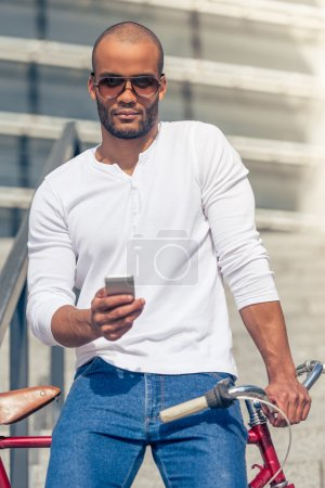 Afro American man with gadget