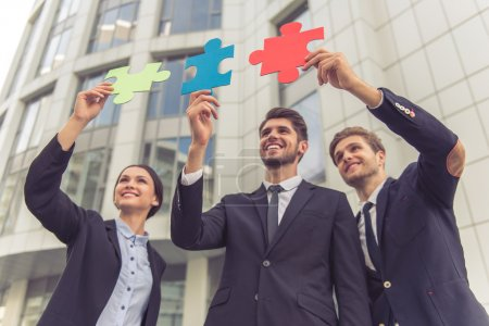 Business people with puzzles
