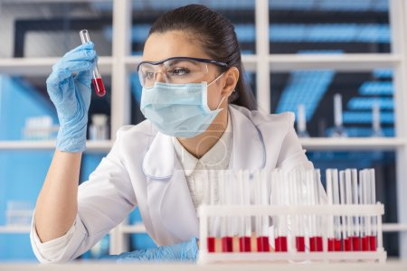 Photo for Attractive female scientist working with a test tube at the laboratory. - Royalty Free Image