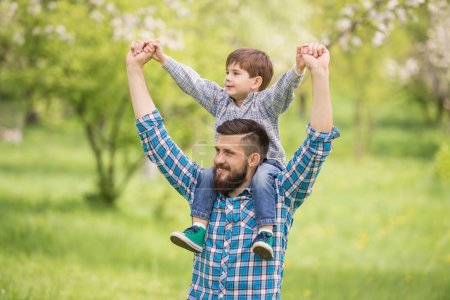 Photo for Little boy and his dad enjoying their time together outside in nature. - Royalty Free Image