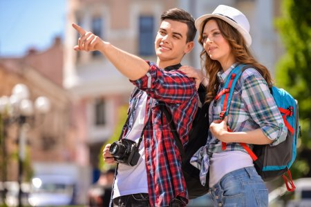 Photo for Young attractive couple walking in old european city. - Royalty Free Image