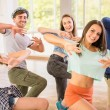 Young dancing people in gym during exercise dancer...