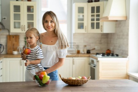 Photo for Mom and child in the kitchen at home - Royalty Free Image