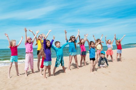 Active happy children on the beach