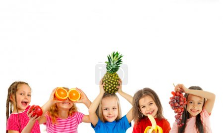 Happy children with fruits