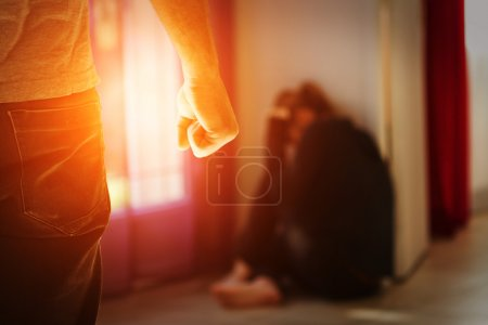 Photo for Man beating up his wife illustrating domestic violence - Royalty Free Image