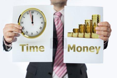 Photo pour Homme au bureau avec les signes du temps et de travail - image libre de droit