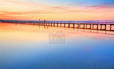Photo for Magnificent colours in the sky, pink towards the north and red towards the south, at  idyllic Long Jetty Central Coast, Australia - Royalty Free Image