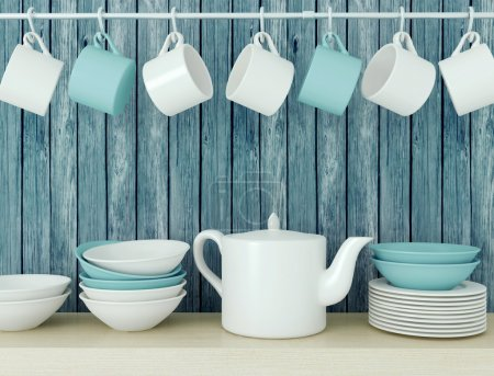 Photo for White ceramic kitchenware on the wooden shelf in front of blue old wood wall. - Royalty Free Image