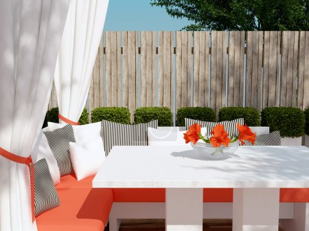 Photo pour Outdoor patio seating area. Big red sofa, black and white pillows. Beautiful flowers on the table. - image libre de droit