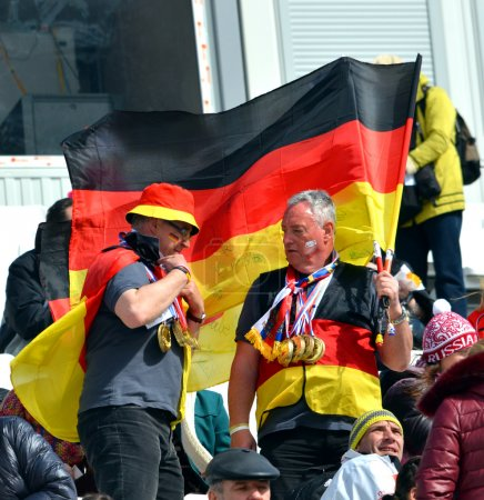 Two sport funs with national flags of Germany