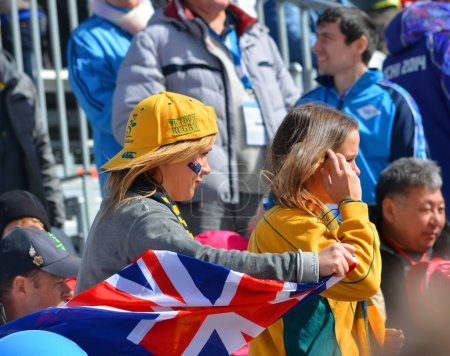 Sport funs of Australia Team with national flags on Winter Paralympic Games 2014