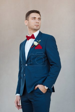 Photo for Portait of a young handsome man in suite. Gorgeous guy on gray background - Royalty Free Image