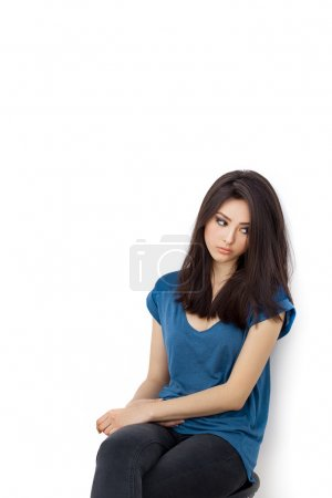 Young bored upset woman sitting on chair
