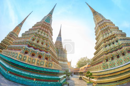 Photo for Chedis decorated with tiles, Wat Pho. Fisheye - Royalty Free Image