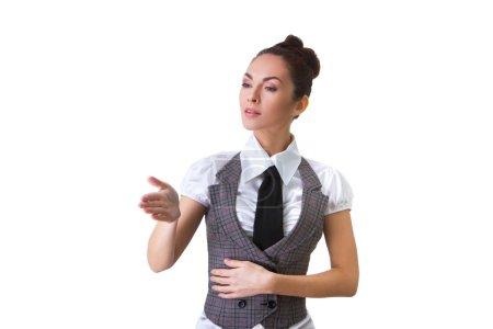 Photo pour Portrait d'une femme d'affaires confiant pointant. Cette photo a été produite avec ces professionnels : maquilleuse, coiffeur et styliste. Un retoucheur professionnel lui a donné la magie finale - image libre de droit