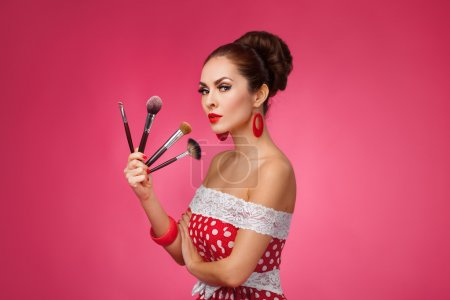 Photo for Beauty Girl with Makeup Brushes. Natural Make-up for Brunette Woman. Beautiful Face. Makeover. Perfect Skin. Pin-Up Retro style - Royalty Free Image