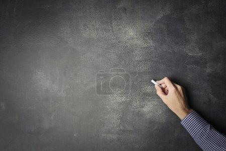 Photo pour Écriture à la main sur un tableau noir avec de la craie - image libre de droit