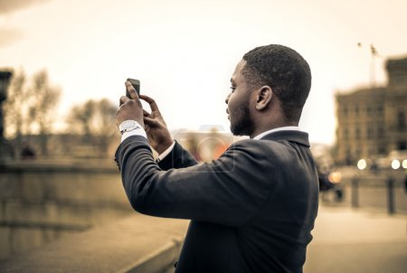 Businessman taking a picture