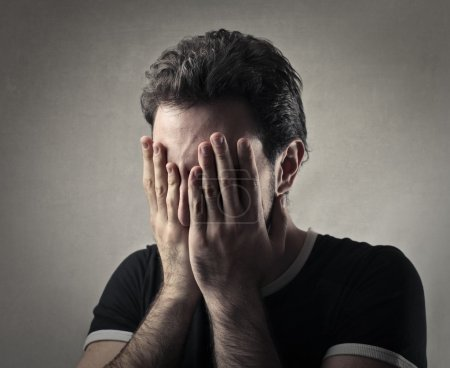Photo for Desolated man with hands over his face - Royalty Free Image