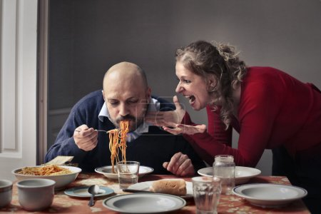 Couple eating and arguing