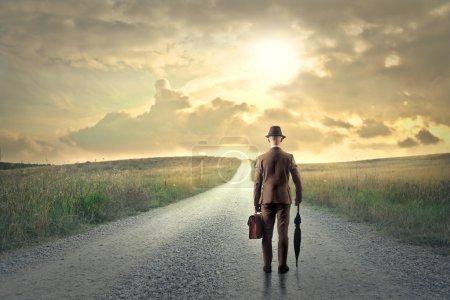 Elegant man walking in the road...