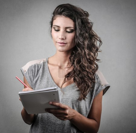 Teenager taking notes