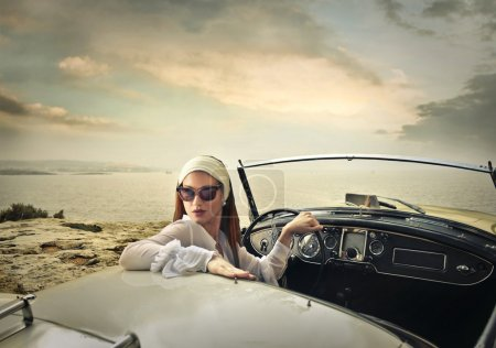 Photo for Elegant woman driving an elegant car - Royalty Free Image
