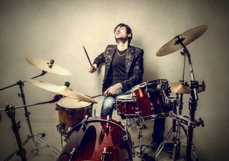 Photo for Young man musician playing drums - Royalty Free Image