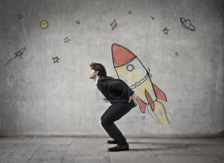 Photo for Business man tied to a pictorial space rocket - Royalty Free Image