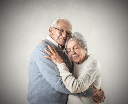 Photo for Portrait of older couple embraced affectionately - Royalty Free Image