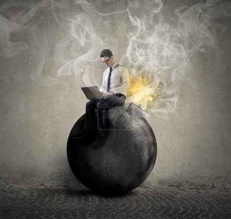 Photo for Businessman sitting on a bomb - Royalty Free Image