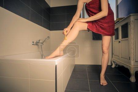 Woman shaving her legs