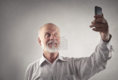 Elderly man doing a selfie
