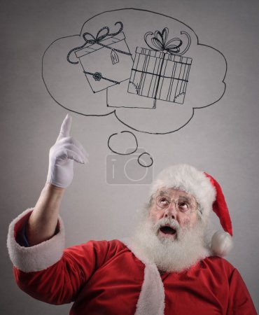 Photo for Santa Claus thinking of presents - Royalty Free Image